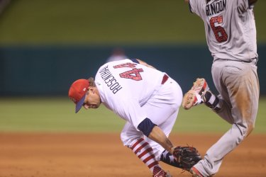 St. Louis Cardinals Trevor Rosenthal tries to make tag