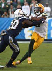 Green Bay Packers' receiver Davante Adams (R) runs for yardage Los Angeles Chargers cornerback Desmond King i