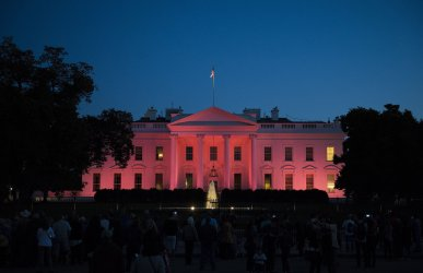 The White House is lit pink for National Breast Cancer Awareness Month