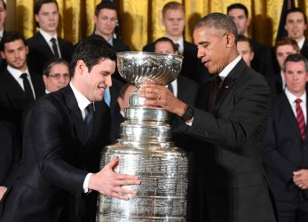 Obama and Sidney Crosby Carry the Stanley Cup at the White House