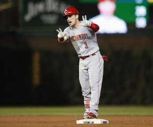 Reds Scooter Gennett reacts after hitting a double against the Cubs in Chicago