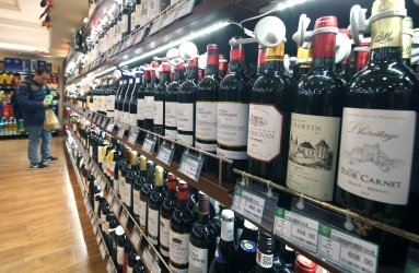 A Chinese man looks at European and American wines in Beijing, China