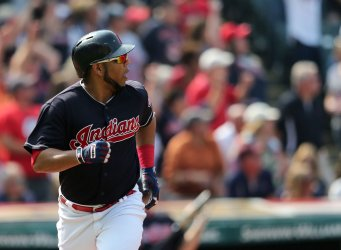 Indians Encarnacion watches his hit leave the park for a two run home run against the Royals