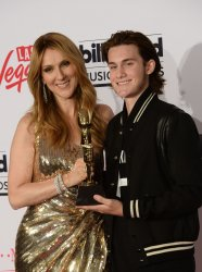 Singer Celine Dion recipient of the  Icon Award poses with her son Rene-Charles Angelil at the Billboard Music Awards in Las Vegas