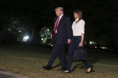 President Donald Trump and first lady Melania Trump arrive at the White House
