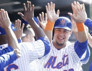 New York Mets Michael Conforto celebrates after scoring a run