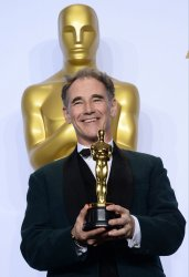 Mark Rylance holds his award backstage at the 88th Academy Awards in Hollywood