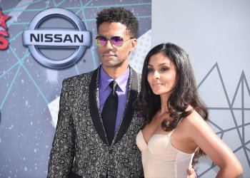 Eric Benet and Manuela Testolinin attend the BET Awards in Los Angeles