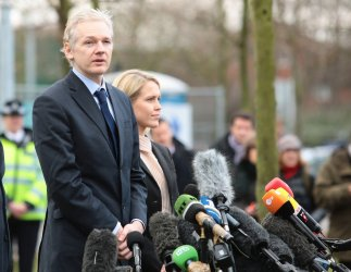 Julian Assange speaks to the media after gaining extended bail