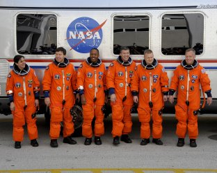 Crew of STS 133 Discovery depart for launch pad at Kennedy Space Center