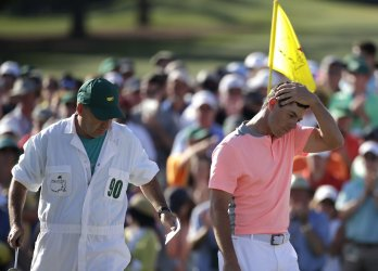 Rory McIlroy walks off of the 18th green at the Masters
