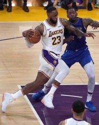Los Angeles Lakers LeBron James drives on Dallas Mavericks Dorian Finney-Smith