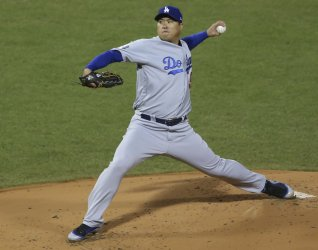 Dodgers pitcher Ryu throws against the Red Sox during first inning in Game 2 of the World Series