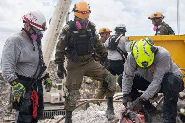 Members of the Israeli Defense Forces Assist in Building Collapse Search