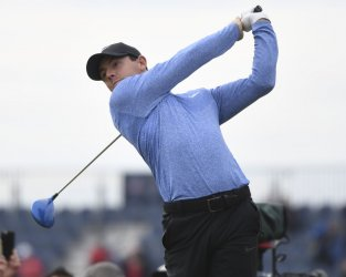 Rory Mcllroy in action at the Open Golf Championship