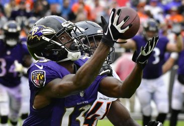 Ravens' John Brown catches long pass for 1st down during an NFL game in Baltimore