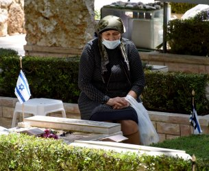An Israeli Visits The Grave Of A Fallen Soldier