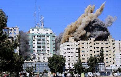 An Israeli Air Strike Demolished the 13-floor Building Housing World Press Offices in Gaza
