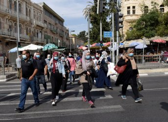Palestinian Muslims Wear Protective Masks In Jerusalem