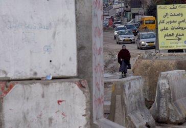 A Palestinian Walks To The Qalandiya Checkpoint Between Jerusalem and Ramallah