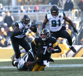 Pittsburgh Steelers Ben Roethisberger is sacked by Jacksonville Jaguars Marcell Dareus with teammates Larentee McCray (L) and Yannick Ngakoue in pursuit