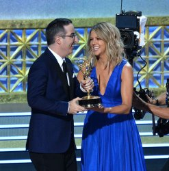 John Oliver and Kaitlin Olson onstage at the 69th annual Primetime Emmy Awards in Los Angeles