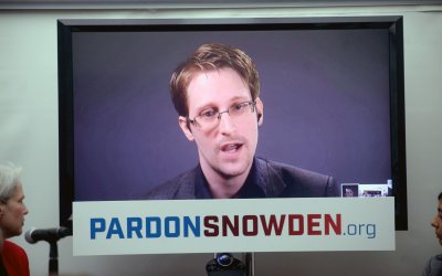 Edward Snowden speaks at a conference