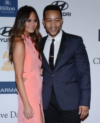 Model Chrissy Teigen and singer John Legend attend the Clive Davis pre-Grammy party in Beverly Hills, California