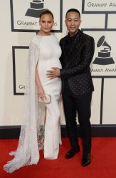 Chrissy Teigen and John Legend arrive for the 58th annual Grammy Awards in Los Angeles