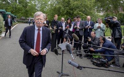 John R. Bolton speaks to the media outside the White House