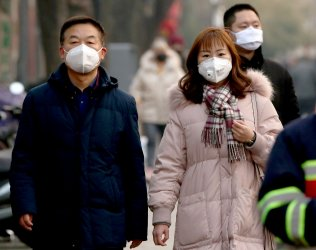 Chinese wear protective face masks due to the virus alert in Beijing, China