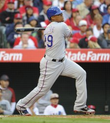 Texas Rangers' Adrian Beltre hits a base hit in the 4th inning against the Los Angeles Angels