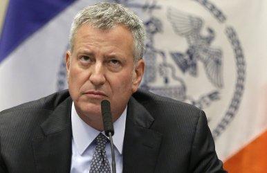 New York Mayor Bill de Blasio listens to a question