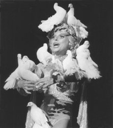 """Actress Carol Channing is covered with doves during the musical """"Sugar Babies"""""""