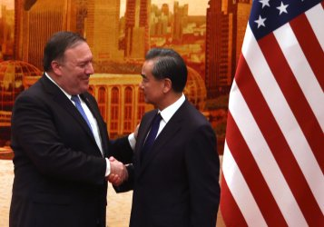 Pompeo and Wang shake hands after a joint press conference in Beijing, China
