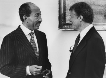 Anwar Sadat and Jimmy Carter confer prior to the historic peace treaty signing