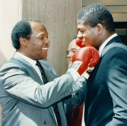 DC Mayor Marion Barry playfully punches heavyweight boxer Riddick Bowe