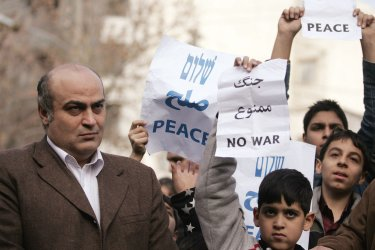 Iranians Jewish participate in a rally to support Gaza in front of U.N office in Tehran.