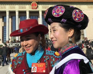 Chinese delegates arrive for the CPPCC in Beijing, China