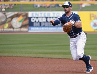 Padres' Kinsler throws to first