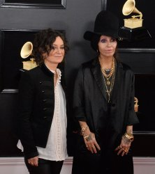 Sara Gilbert and Linda Perry arrive for the 61st Grammy Awards in Los Angeles