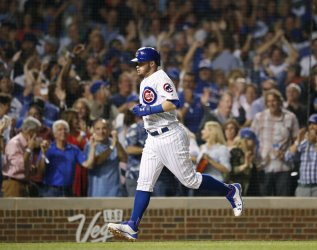 Cubs Ian Happ hits three-run home run against the Reds in Chicago
