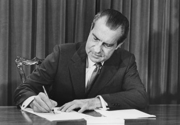 President Richard Nixon delievers signs message he delviered to Congress to help rural farmers