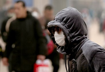 Chinese wear protective masks in Beijing, China