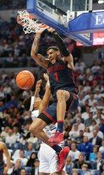 Dayton's Obi Toppin slams basketball for two points