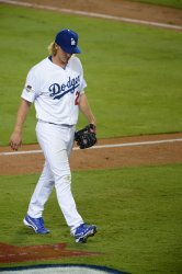 Dodgers pitcher Greinke relieved in the seventh inning against the Mets