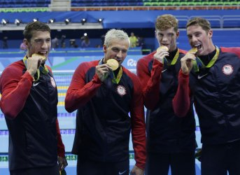 Michael Phelps celebrates with gold after Men's 4x200m
