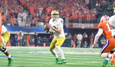 Notre Dame's Ian Book looks for an open receiver against the Clemson defense