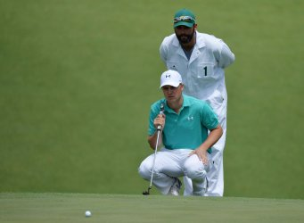 Caddie Michael Greller and Jordan Spieth at the Masters