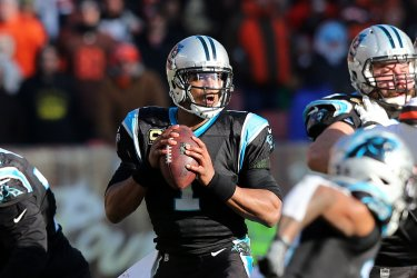 Panthers Newton looks to pass against the Browns